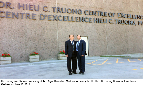 Steven with Dr. Hieu in front of the Dr. Hieu C. Truong Centre of Excellence building